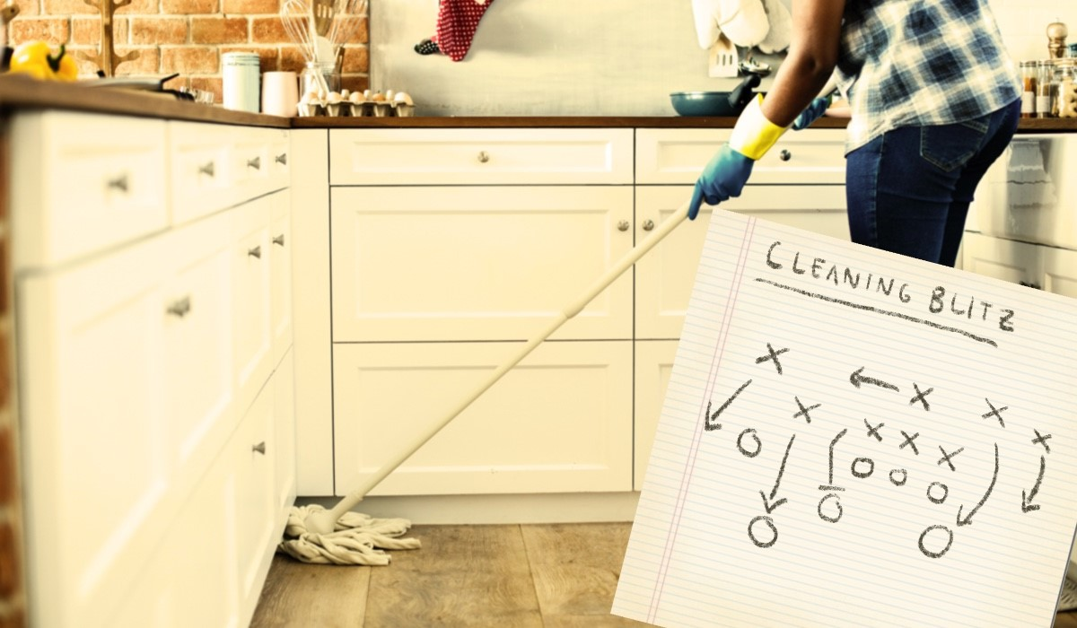 woman mopping the kitchen floor
