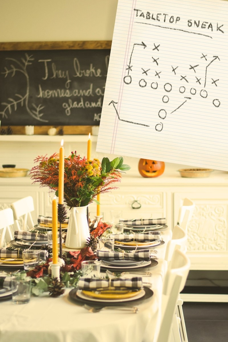 table set for Thanksgiving with gingham napkins and yellow candles