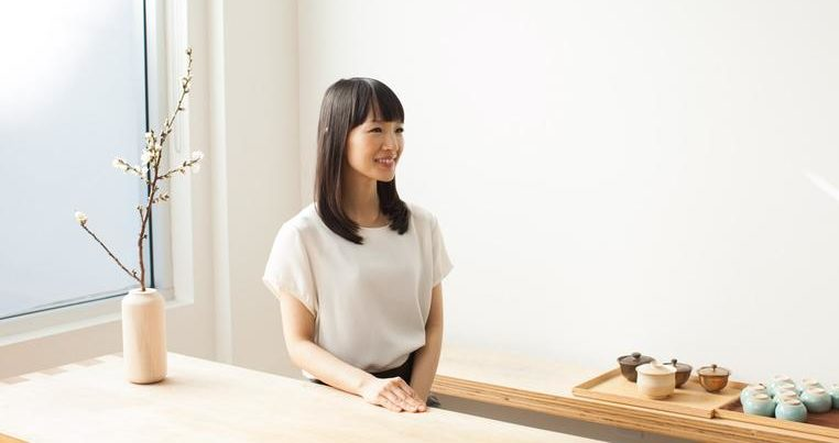Marie Kondo sitting at a table