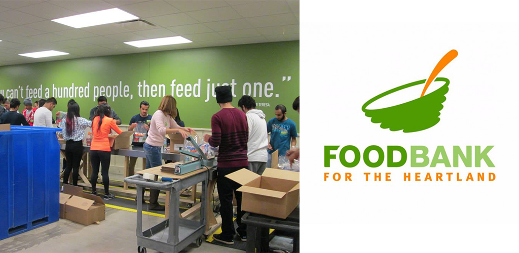 People loading boxes on an assembly line for Food Bank for the Heartland