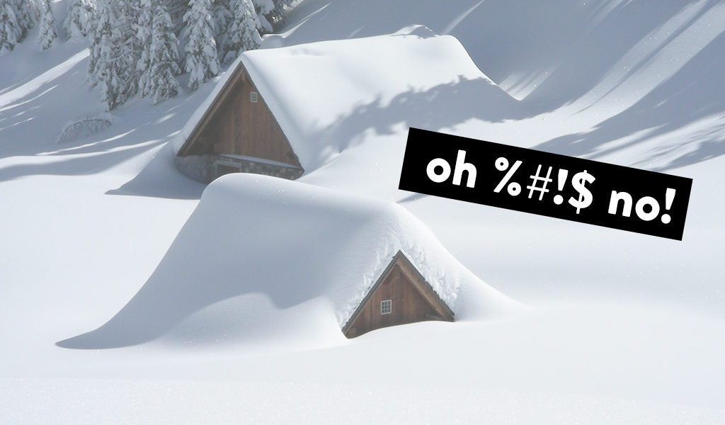 two houses almost completely buried in snow